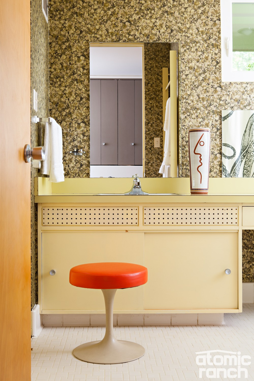 Midmod details orange bathroom