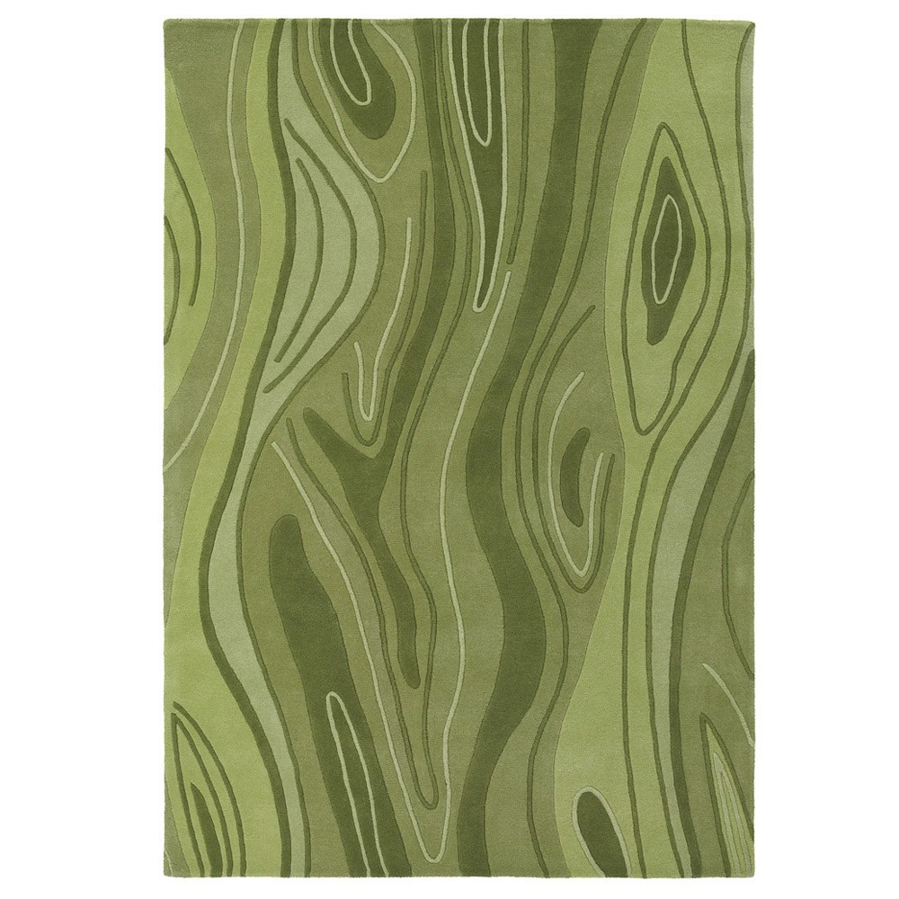 A mid century area rug with a green color scheme and tree-wood pattern.