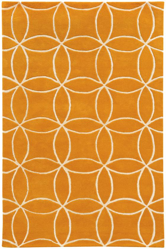 A sun-kissed orange rug with an array of overarching circles for a pattern.
