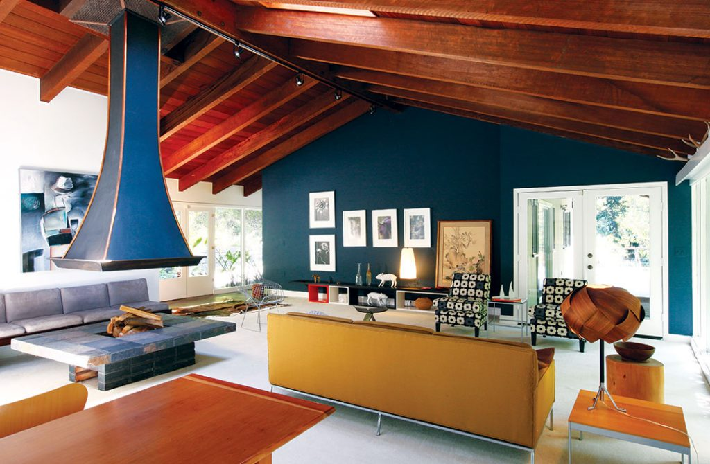 mid century modern living room with blue walls