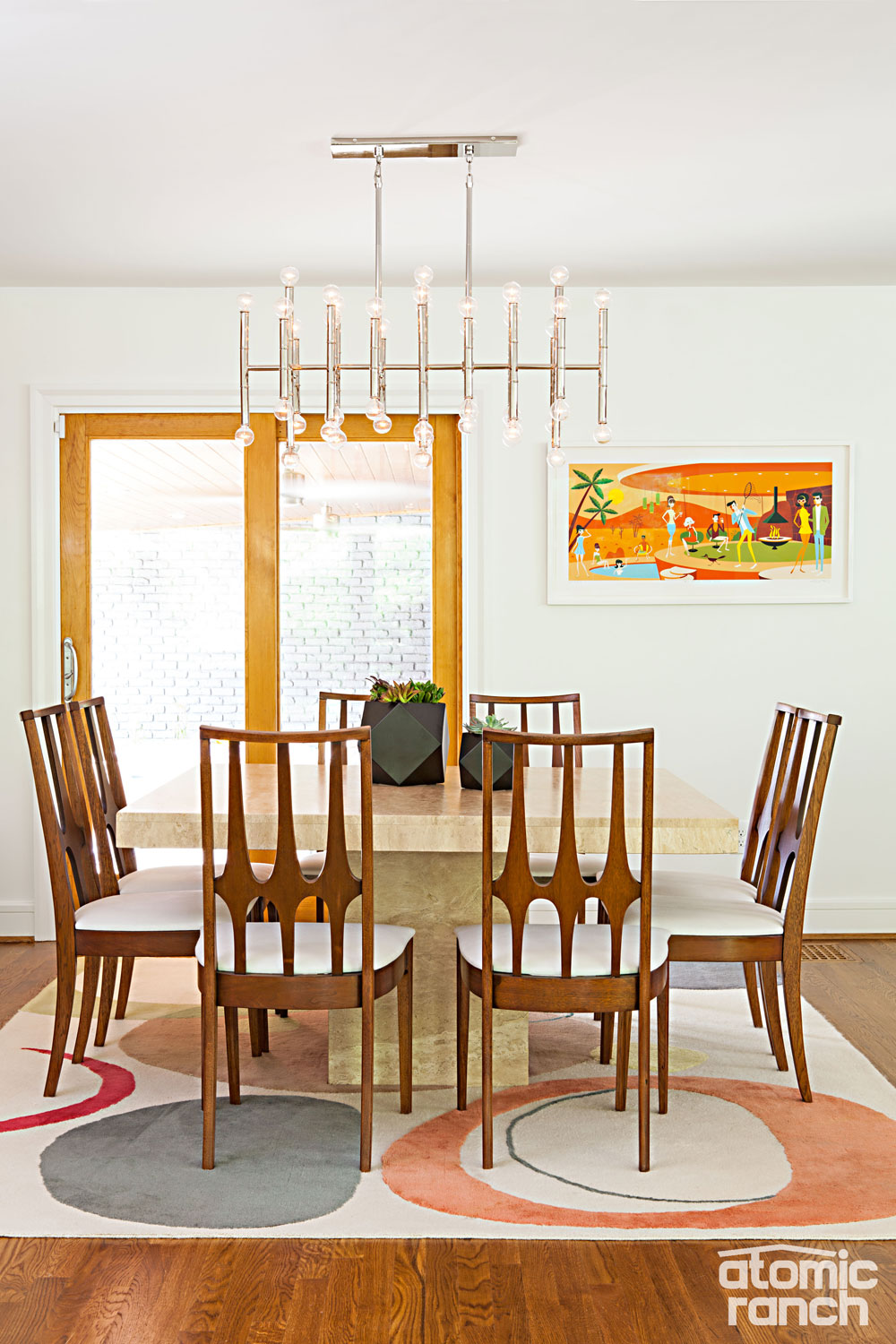 colorful mid mod details and furniture stories of a north carolina mcm dining room jonathan adler chandelier