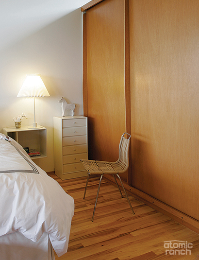 Bedroom with original floors and Kjaerholm PK1 rope chair