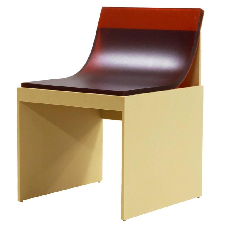 501 Chair can be found here. This chair is made out of corian with a cast industrial rubber slab seat.