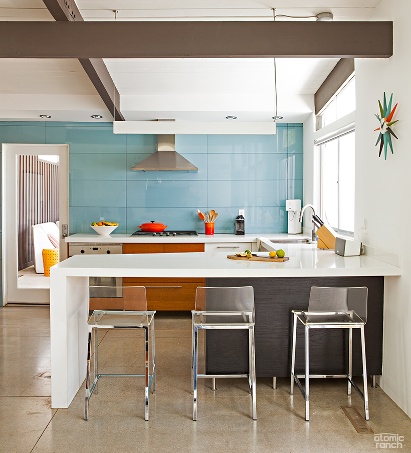 kitchen with custom counter and tile