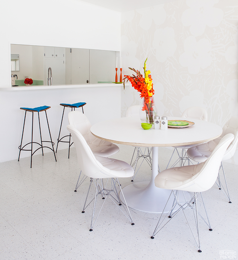 Tulip table and vinyl dining chairs