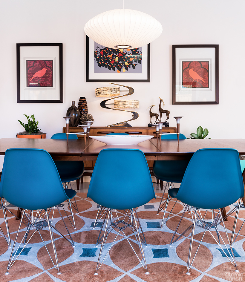 midcentury dining room with bubble lamp and Eames Eiffel chairs