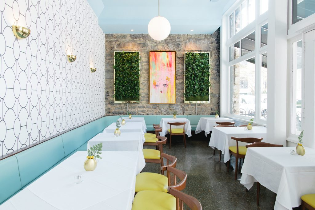 the dining room of terra me is a wonderful mix of art deco and midcentury vibes from the hotels signature bold wallpaper to the danish style dining