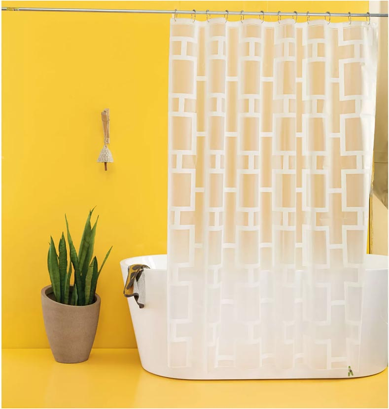 frosted clear breezeblock shower curtain in a yellow bathroom with a modern tub. perfect for a mid century modern bathroom upgrade in a weekend