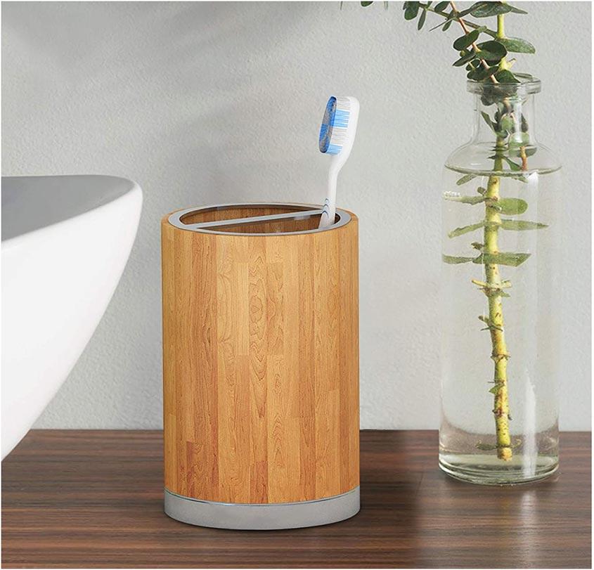 Round wooden toothbrush holder.