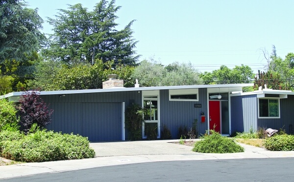 As a part of many mid-mod towns, this Palo Alto home is complete with an Eichler design and red door-ed exterior.