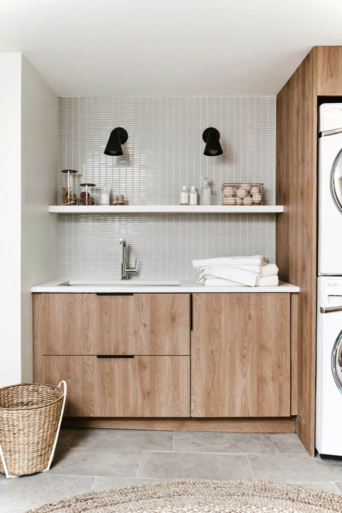 An MCM laundry room that has been done over with sandalwood-looking cabinets.