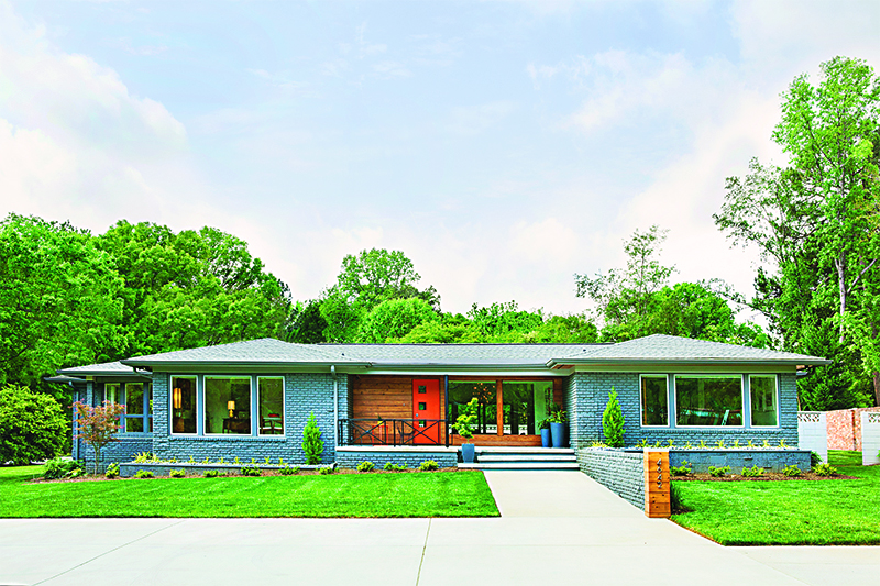 A mid century home that makes use of soft blue tones.