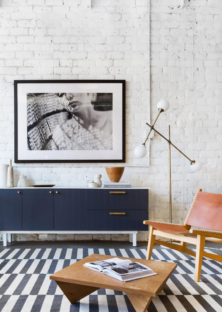 A mid century living room complete with a wooden, navy-colored credenza refashioned by Semihandmade.
