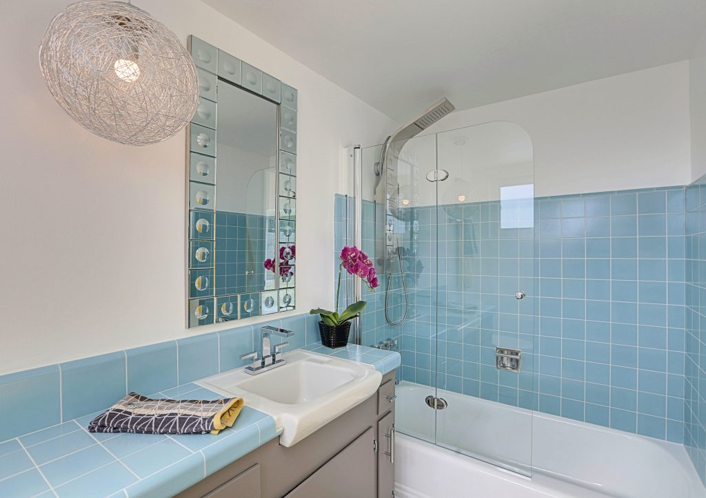 bathroom vintage tile vintage blue tile Flipping Diaries preservation renovation Atomic Ranch
