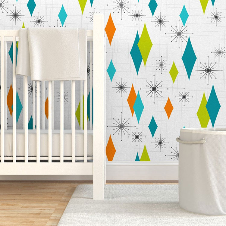 mid century modern wallpaper with diamond green, orange and turquoise pattern with starburst flourishes on white background