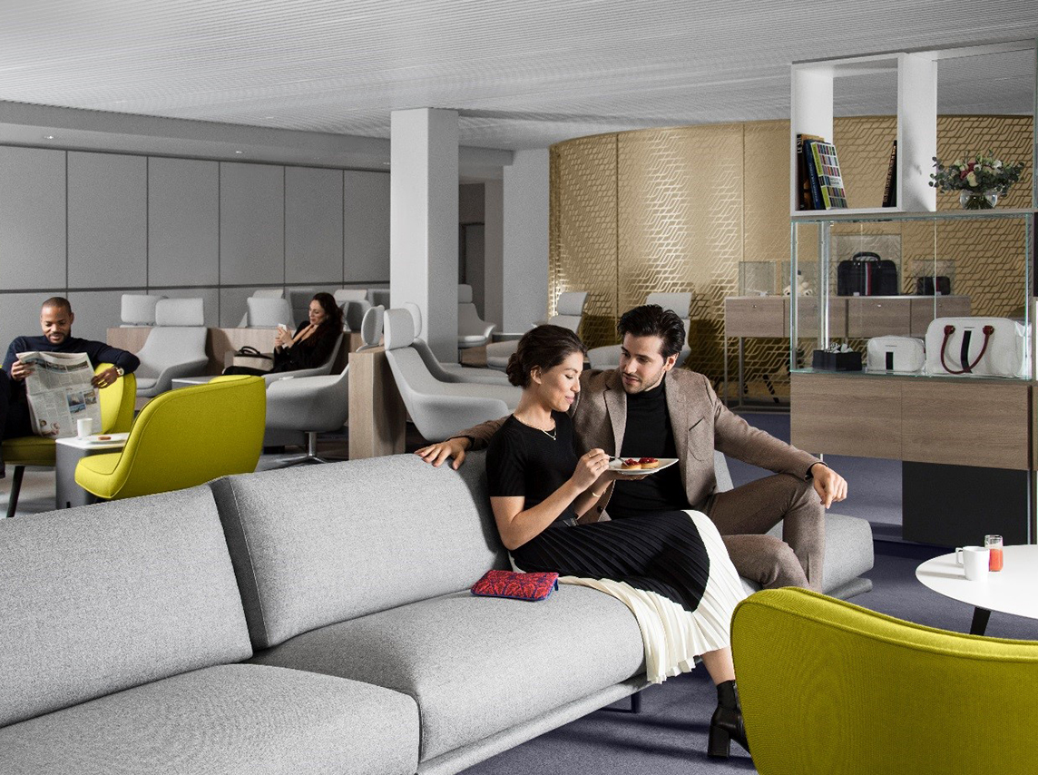 Sitting area in the new Air France business lounge featuring Midcentury Modern-inspired design, which is located in Paris's Charles de Gaulle airport.