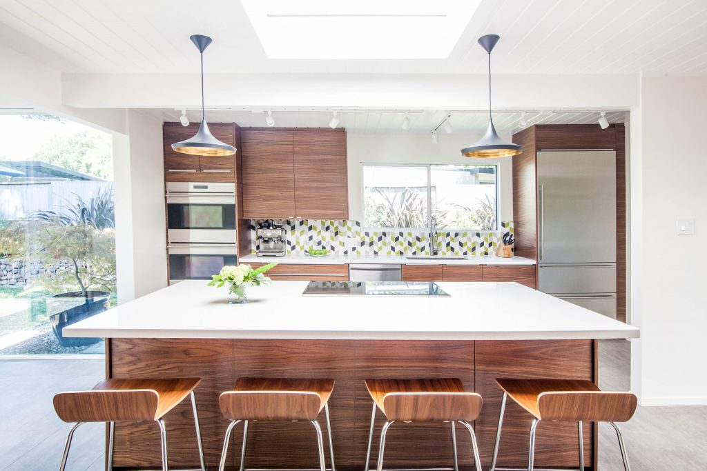 Previous renovations traded the midcentury modern kitchens original details for a traditional style design something joe and mark were ready to replace in