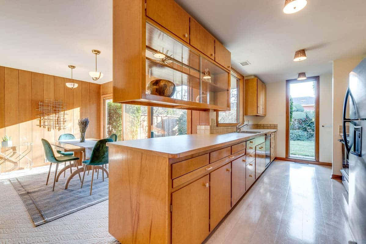 The glass plated cabinetry of a mid century kitchen.
