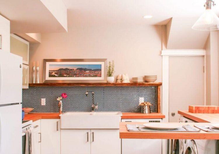 A mid century kitchen with small elements that highlight the unique dotted tile-scheme.