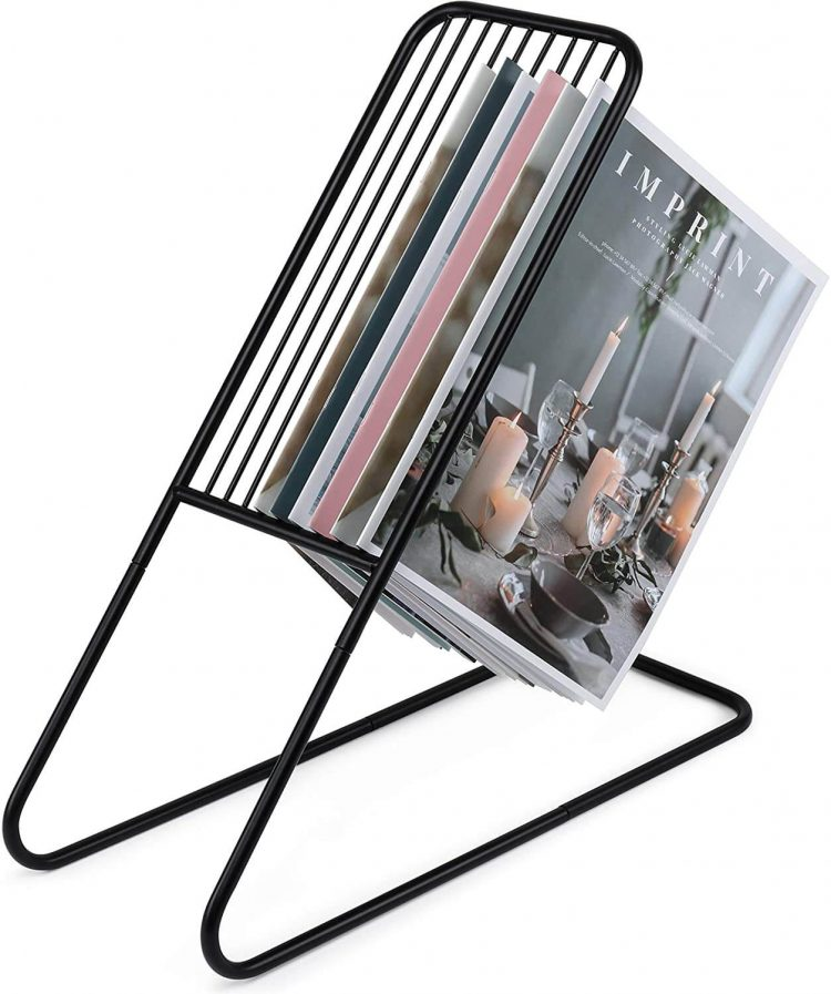 Iron mid century modern magazine rack with a zig zag base.