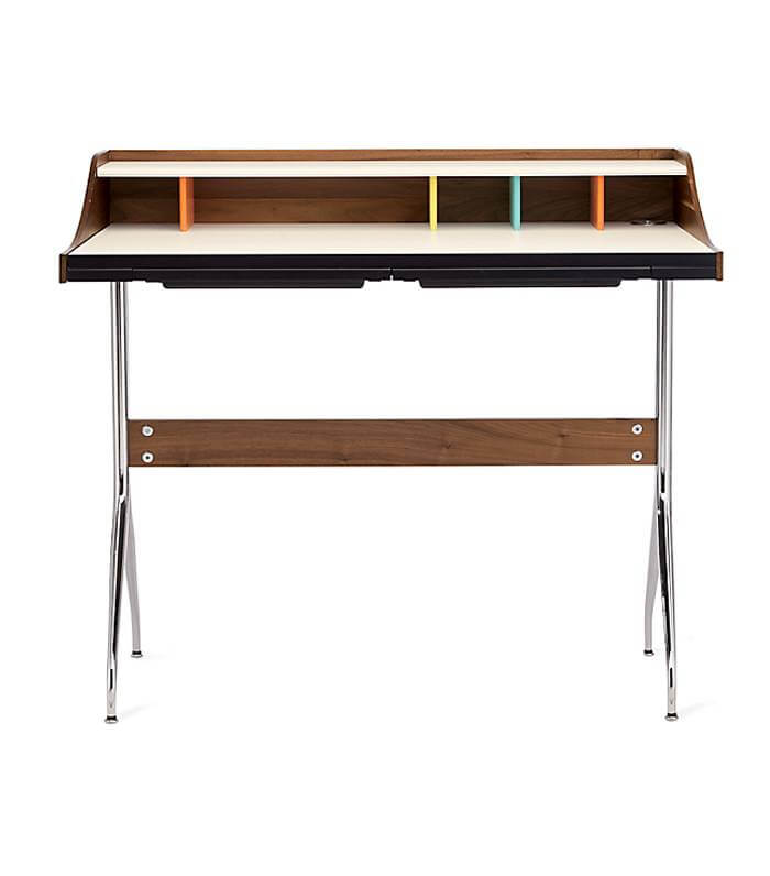 This midcentury style desk is simple, but still unique with pops of color and silver hardware.