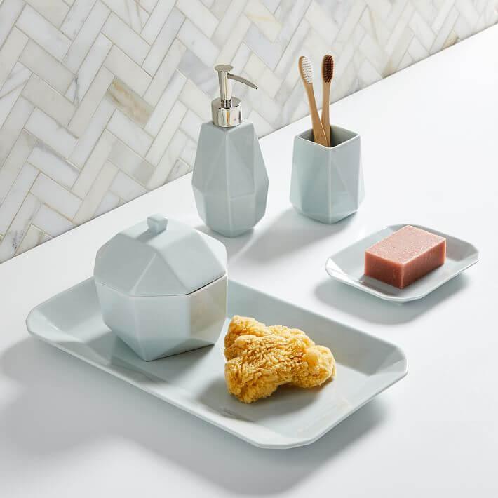 Mid century blue porcelain bathroom update accessories.