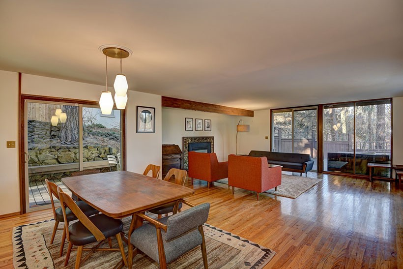 Mid Century Modern open floor plan living and dining room with oak floors