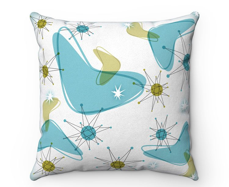 mod boomerang pattern throw pillow with blue and green boomerangs on a white background