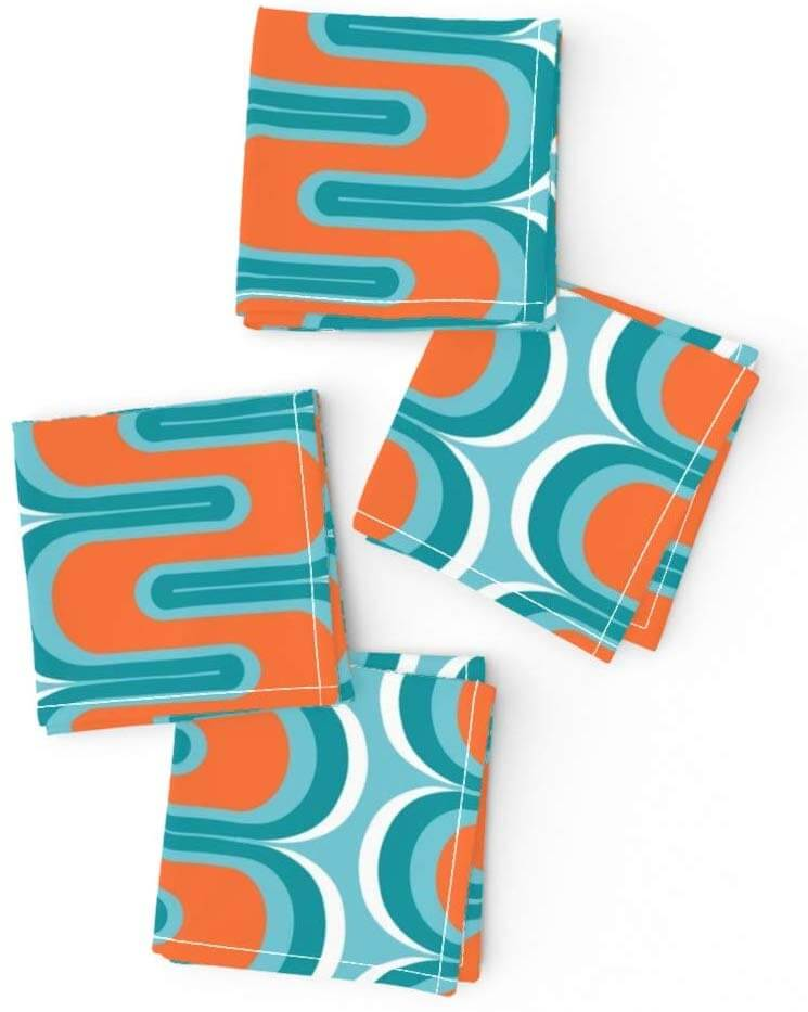 Kitchen and dining table napkins with blue and orange designs.