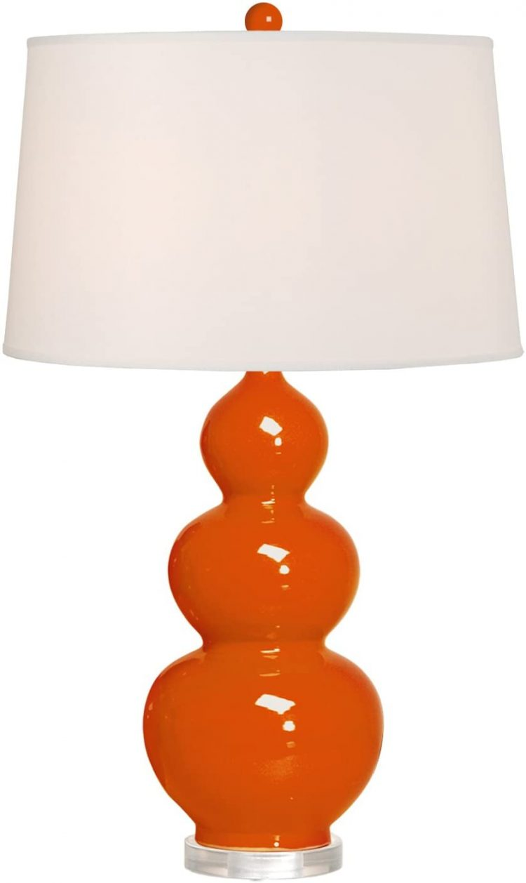 Lamp with triple gourd body and orange hue.