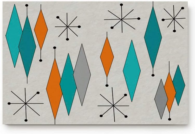 Bed and bath starburst mat with gray, orange, and silver geometric designs.