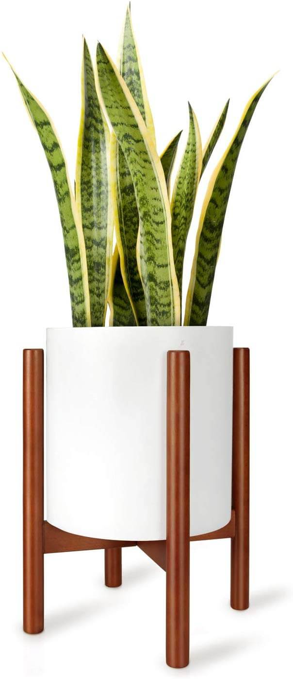 A planter with a white pot and wood holder.