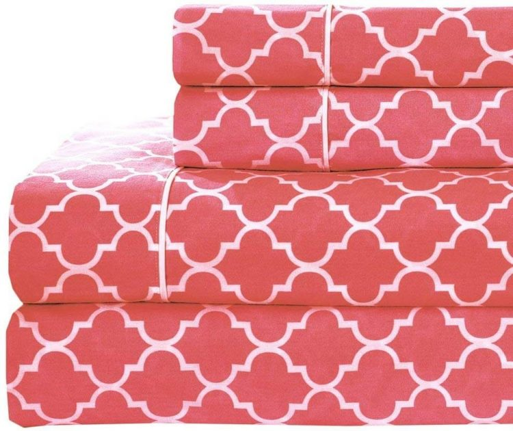 Bed and bath red sheets with geometric design.