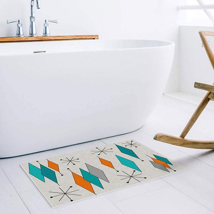 starburst bathmat in front of a modern sleek white bathtub