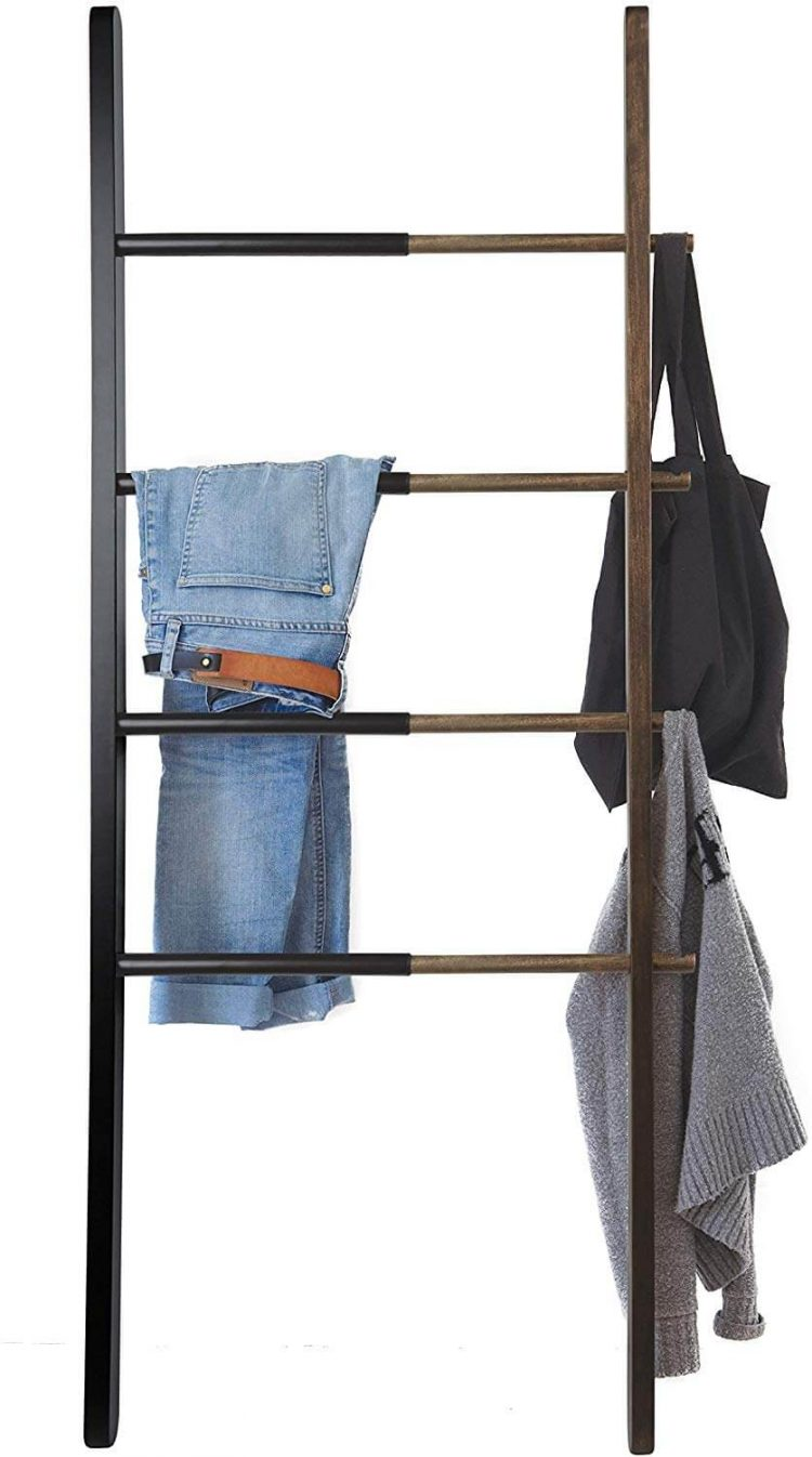 Bed and bath ladder with clothes draped over the rungs.