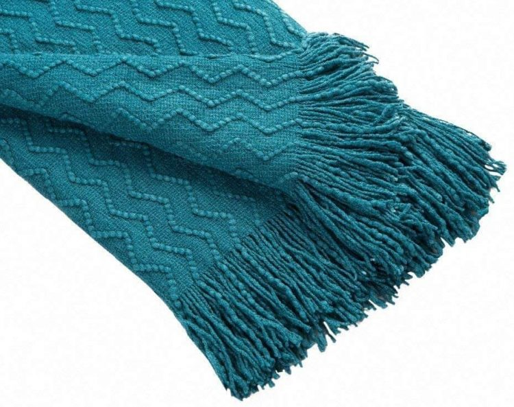 Bed and bath blue woven blanket.