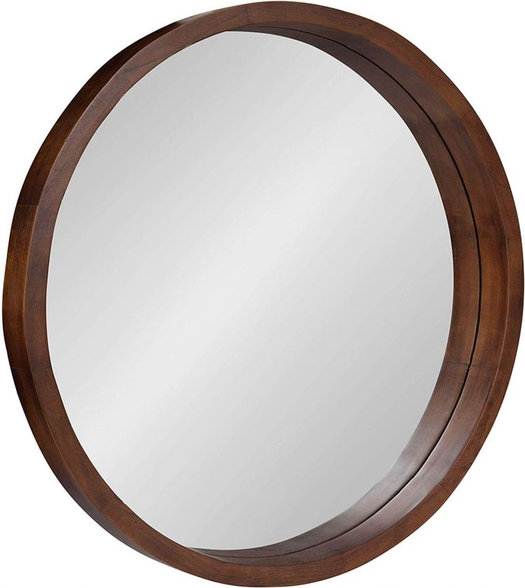 Mid century circle mirror with wood frame.