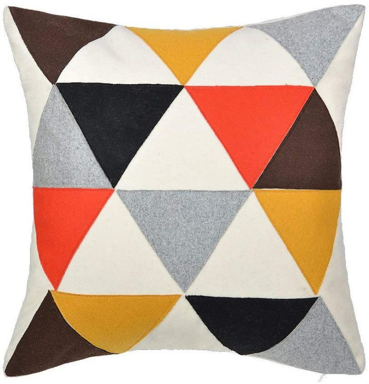 Mid century modern pillow with multi-colored triangle design.