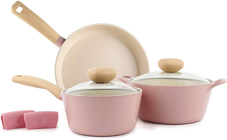 Kitchen and dining set of pastel pink cookware.
