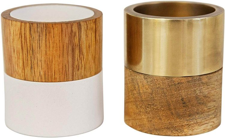 Mid century candle holders with wood, gold, and solid white components.