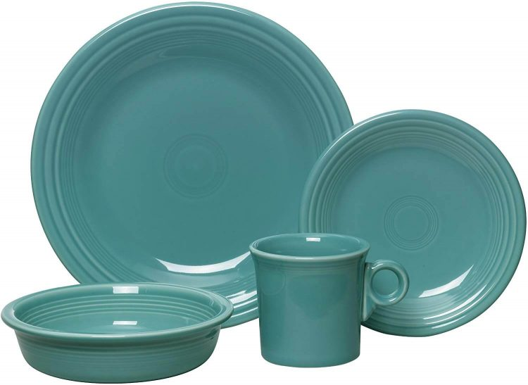 A kitchen and dining plate, bowl, and cup in a teal ceramic glaze.