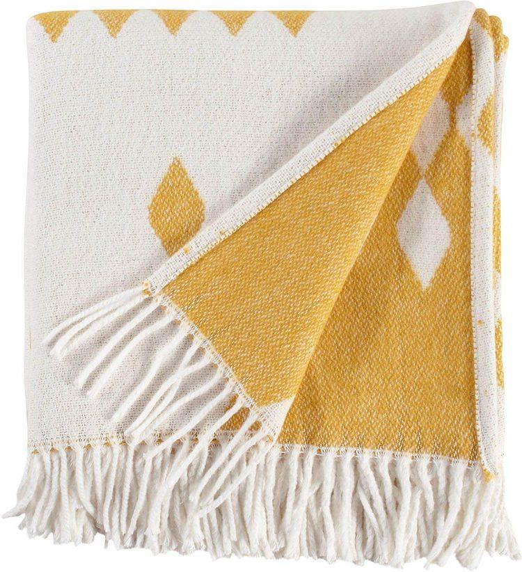 Fleece blanket with yellow diamond design.