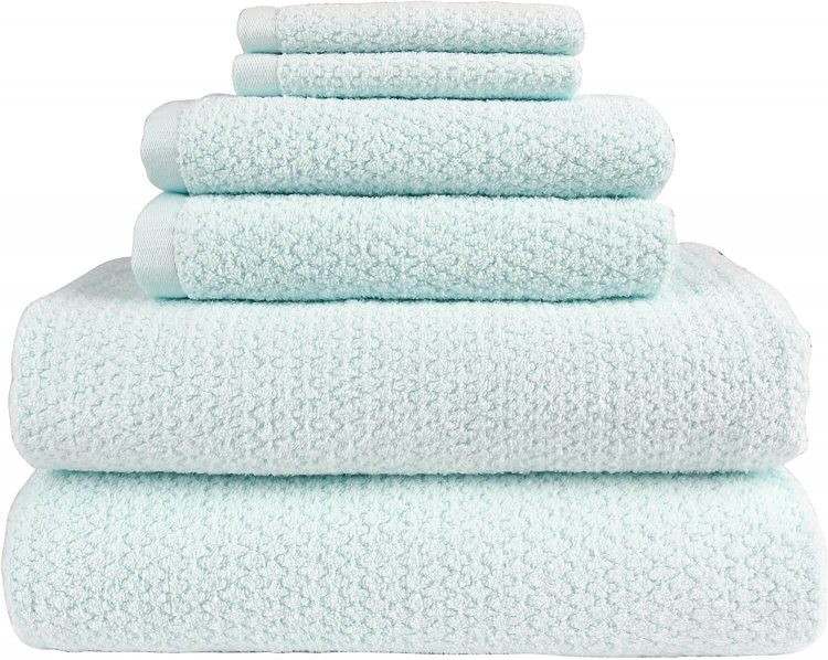 Spearmint bed and bath towels with a minimal repeating geometric design.