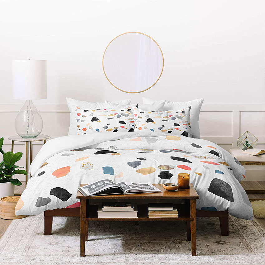 mid century modern bedding set with a terrazzo pattern on white background