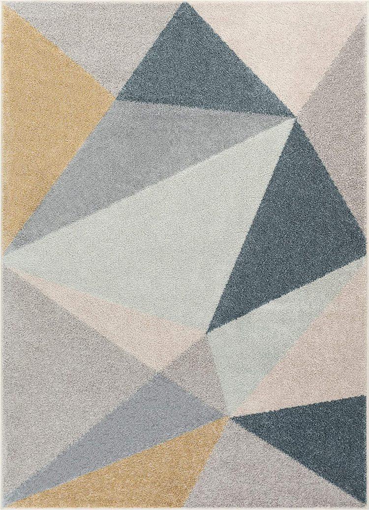 Area rug with multicolored triangle geometric desgin.
