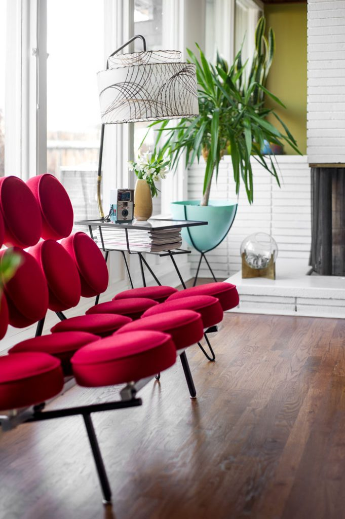 A bright red George Nelson Marshmallow Sofa is undoutedly the star of the show—perfectly accented by the vintage side table that does triple duty as a magazine rack and lamp.