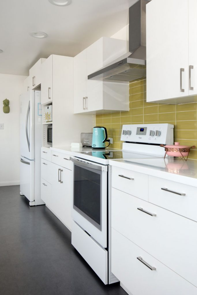 Mod green and white kitchen with black floors
