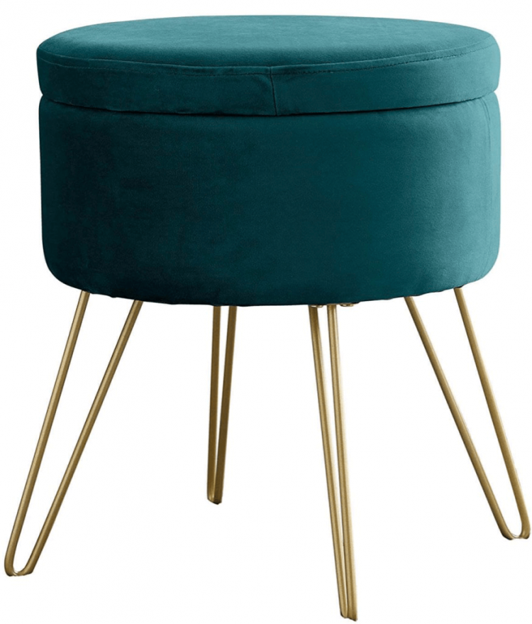 Blue ottoman with brass wire legs.