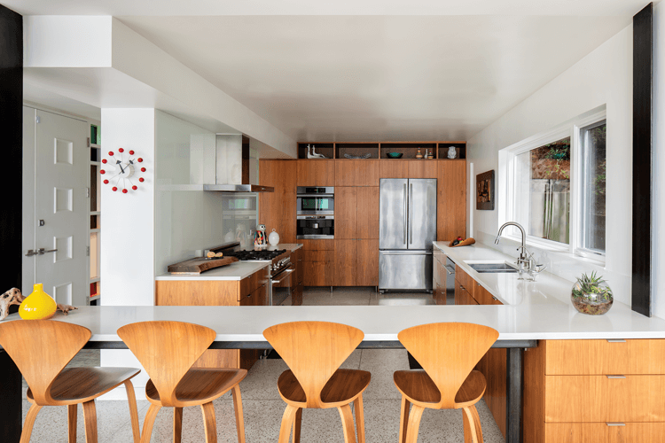 A Mid Century Modern kitchen with wood cabinetry