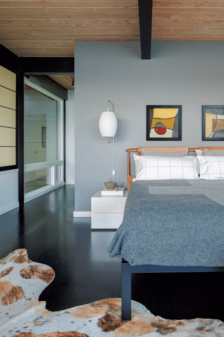 Mid Century Modern lake house bedroom with a soothing gray color scheme.